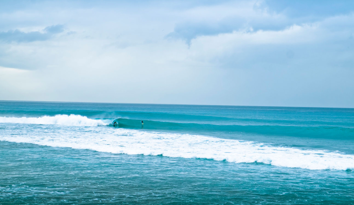 """We stumbled upon a Rip Curl Grom-Search contest while we were in Guadeloupe. While the kids battled each other on the inside trying to impress the judges and potential sponsors with mini-airs, this girl on a knee-board kept snagging amazing lefts at the empty reef. Photo: <a href=\""""http://www.justinjay.com\"""" target=\""""_blank\"""">Justin Jay</a>"""