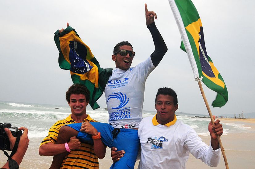 The young Brazilian champ getting chaired up the beach. Photo: ISA/Tweddle