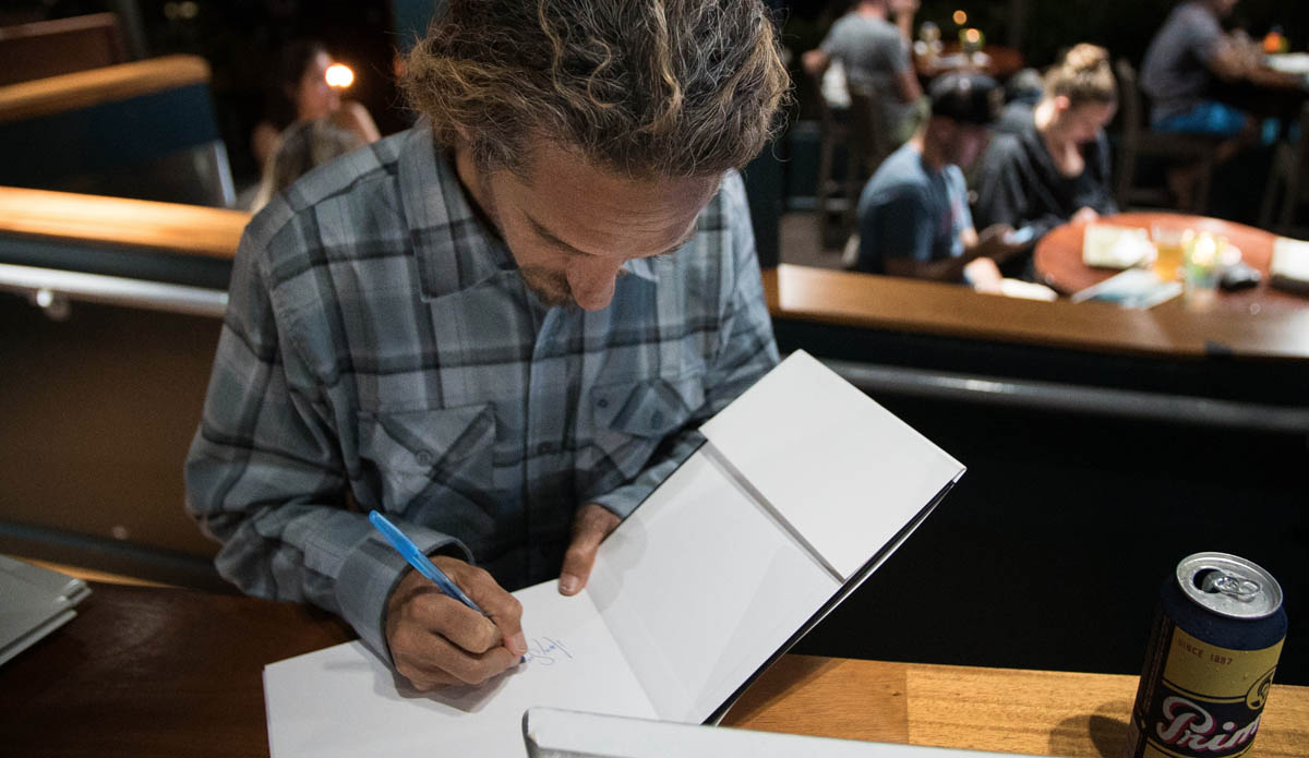 Following the film, we gave away a bunch of free stuff, including The Inertia\'s 5-year anniversary book signed by Rob Machado himself. Photo: Juicewhale