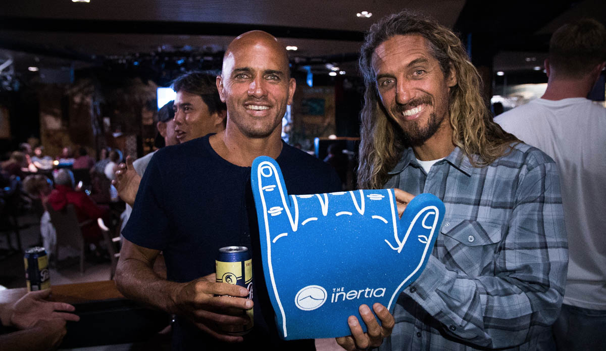 20 years later, two of surfing\'s most respected figures come together to celebrate the most iconic high five in surf history. Photo: Juicewhale