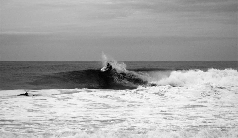 """This is a shot of Tom Petriken with Luke Ditella paddling. These two surf a lot together and like to find big jetties to themselves. Image: <a href=\""""http://mikeincitti.com/\"""" target=\""""_blank\"""">Incitti</a>"""