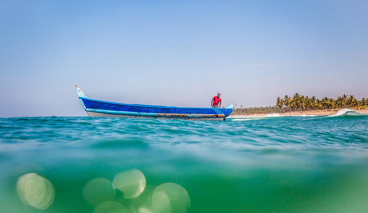 """Fisherman in the boat. Photo: <a href=\""""http://www.Godoberta.com\"""">GodoBerta.com</a>"""