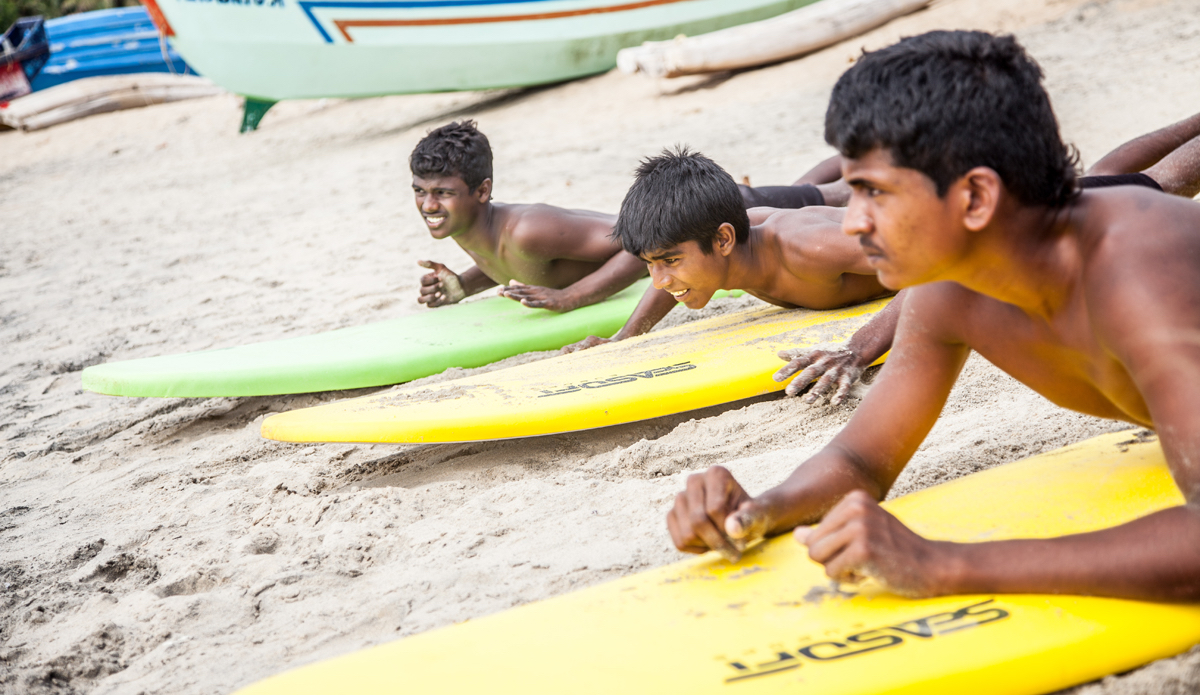 """Yousaf, Habeeb and Nabill are learning to paddle and pop up on the board, during the Sunday surf club. Photo: <a href=\""""http://www.Godoberta.com\"""">GodoBerta.com</a>"""
