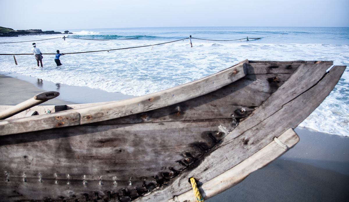 """Fishermen are dragging fishing nets to the shore, meanwhile boats rest on the shore. Photo: <a href=\""""http://www.Godoberta.com\"""">GodoBerta.com</a>"""