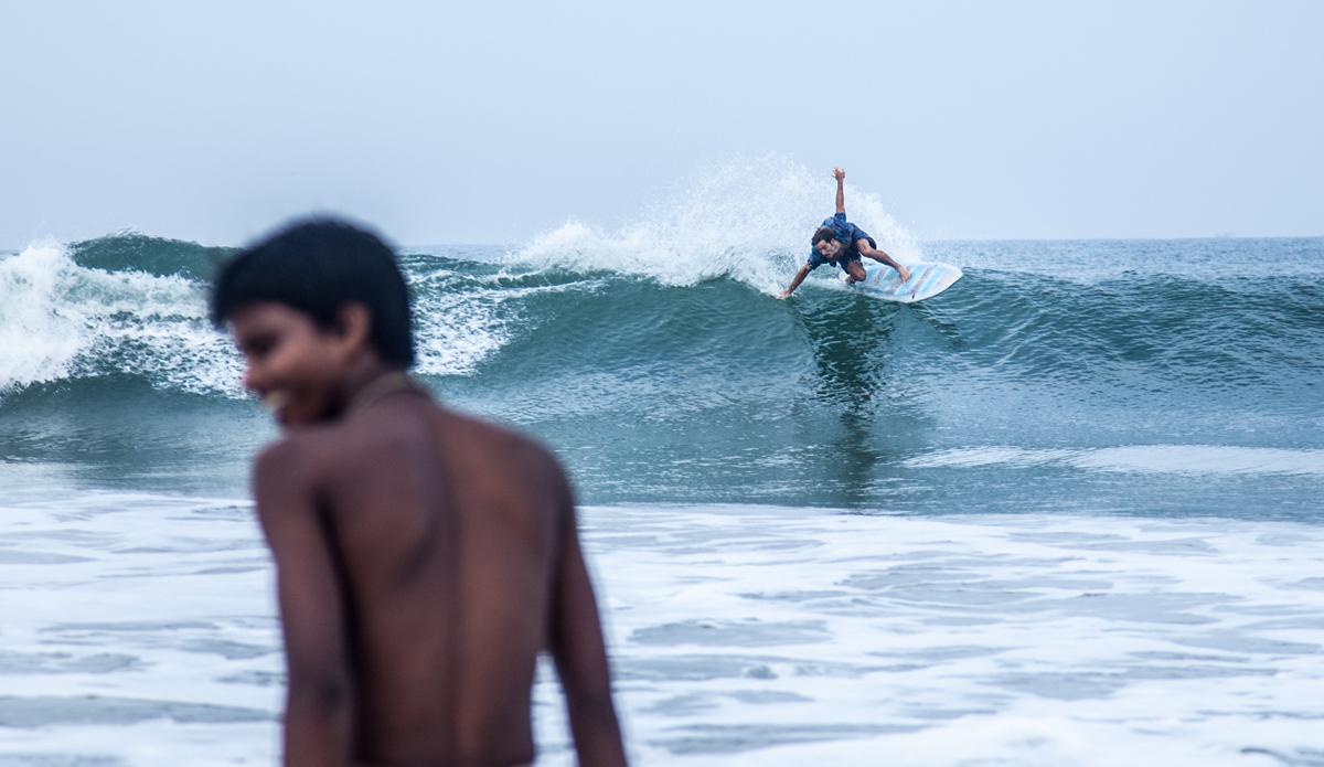 """Local boy is watching Franco ripping the waves. Photo: <a href=\""""http://www.Godoberta.com\"""">GodoBerta.com</a>"""