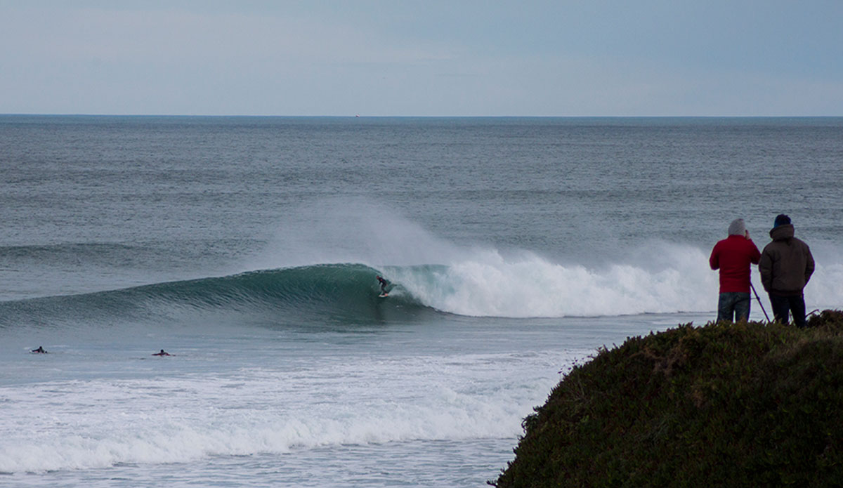 Esteban Hermida getting piped at home. Angel Fotosplino, foreground, is the most important photographer of the south coast seen here making a visit to the northern reaches. Photo: Irene Aneiros