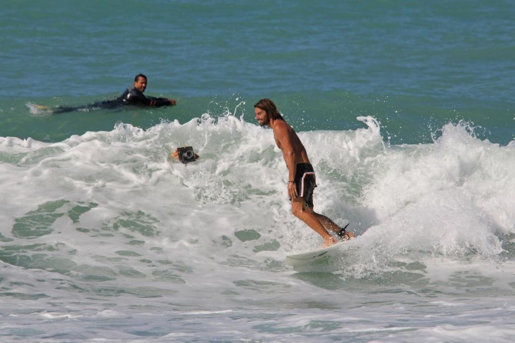 The Australian surfer Dave Rastovich riding small fun waves on the Tuscany coast. Photo: Bella Vita