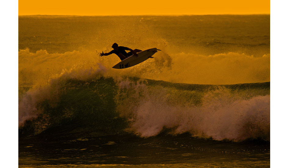Grom shredder Nomme Mignot punts an indy at V-Land during golden hour. Photo: Jason Naudé
