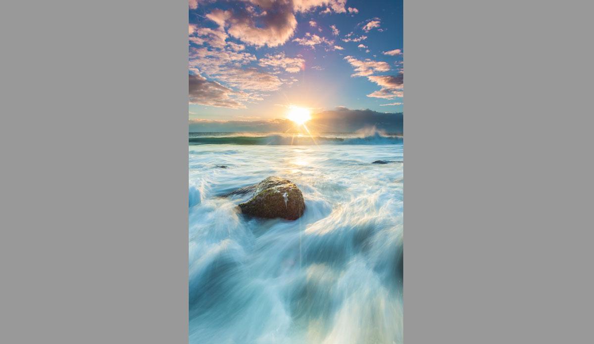 "A horizon of clouds during sunrise over Rainbow Bay. Photo: <a href=\""http://jessethompsonphotographer.com/\""> Jesse Thompson</a>"