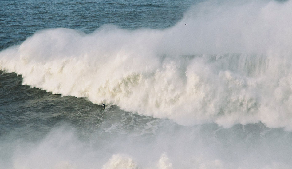 """Andrew Cotton about to get swallowed alive. Photo: <a href= \""""http://joaobracourt.com/\"""" target=_blank>Joao Bracourt.</a>"""