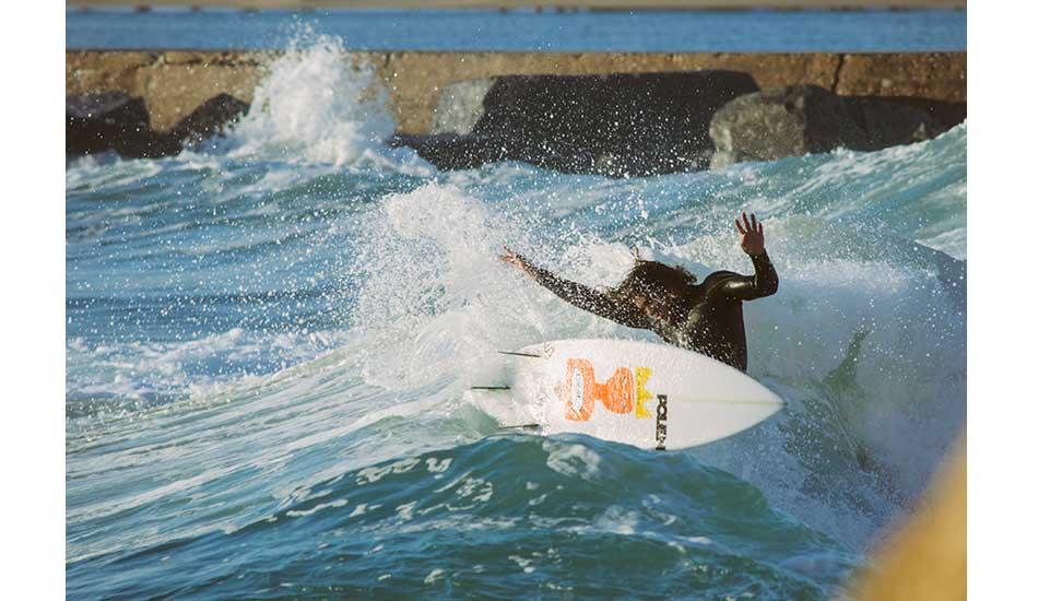 "Joackim gets every fin out. Still holds on. Photo: <a href= \""http://joaobracourt.com/\"" target=_blank>Joao Bracourt.</a>"