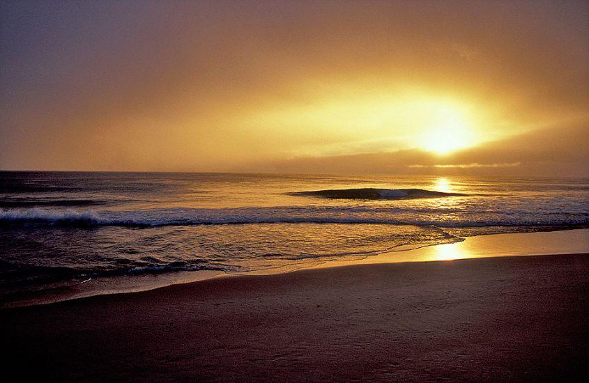 "Sunrise. Tasmania. Photo: <a href=\""http://www.joecurren.com\"" target=_blank>Joe Curren</a>"