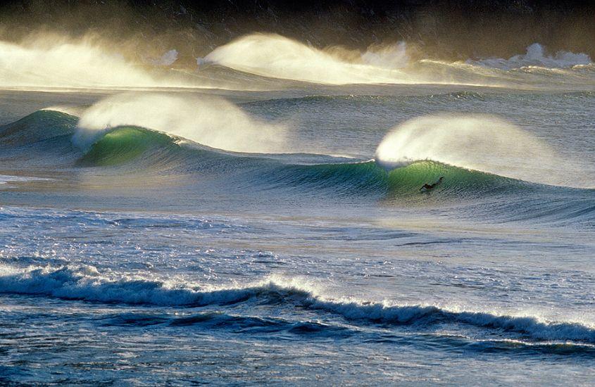 """Surfer, morning light. New Zealand. Photo: <a href=\""""http://www.joecurren.com\"""" target=_blank>Joe Curren</a>"""