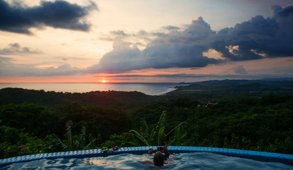 The view from Venatana A Las Ola\'s pool. No better way to finish a day than a sunset and cold Tona.