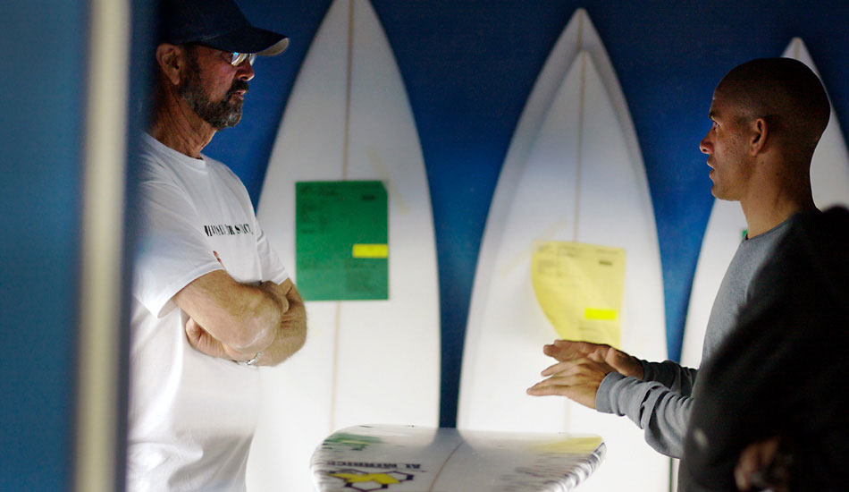 "Al Merrick and Kelly discussing the anatomy of surfboards and what makes them work. Photo: <a href=""http://lowtiderising.com/\"" target=_blank>Aroyan/lowtiderising.com</a>"