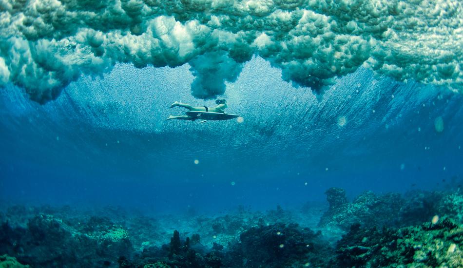 "Carissa Moore sneaking under one in Micronesia. Image: <a href=\""http://www.jrkenworthy.com/\"" target=\""_blank\"">Kenworthy</a>"