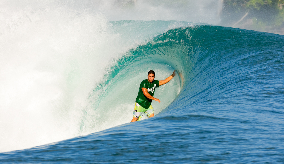 """Kai Barger has taken on the tradition of being a true Hawaiin tube rider. Here he is putting his skills to work at Green Bush. Image: <a href=\""""http://www.jrkenworthy.com/\"""" target=\""""_blank\"""">Kenworthy</a>"""