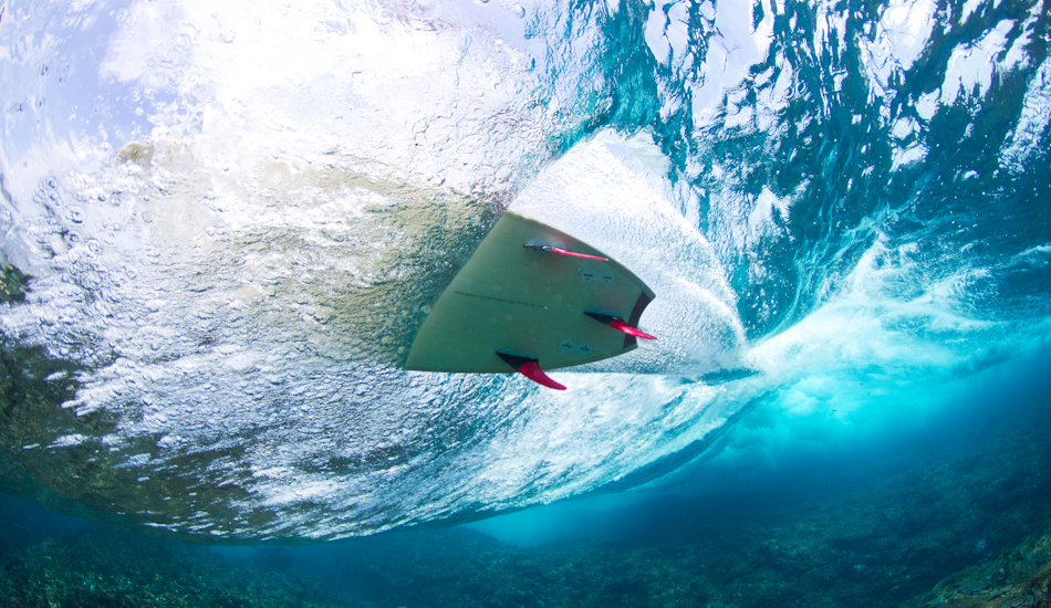 """Hand made all wooden Spirare Surfboard being taken for a spin over a shallow reef pass. Image: <a href=\""""http://www.jrkenworthy.com/\"""" target=\""""_blank\"""">Kenworthy</a>"""