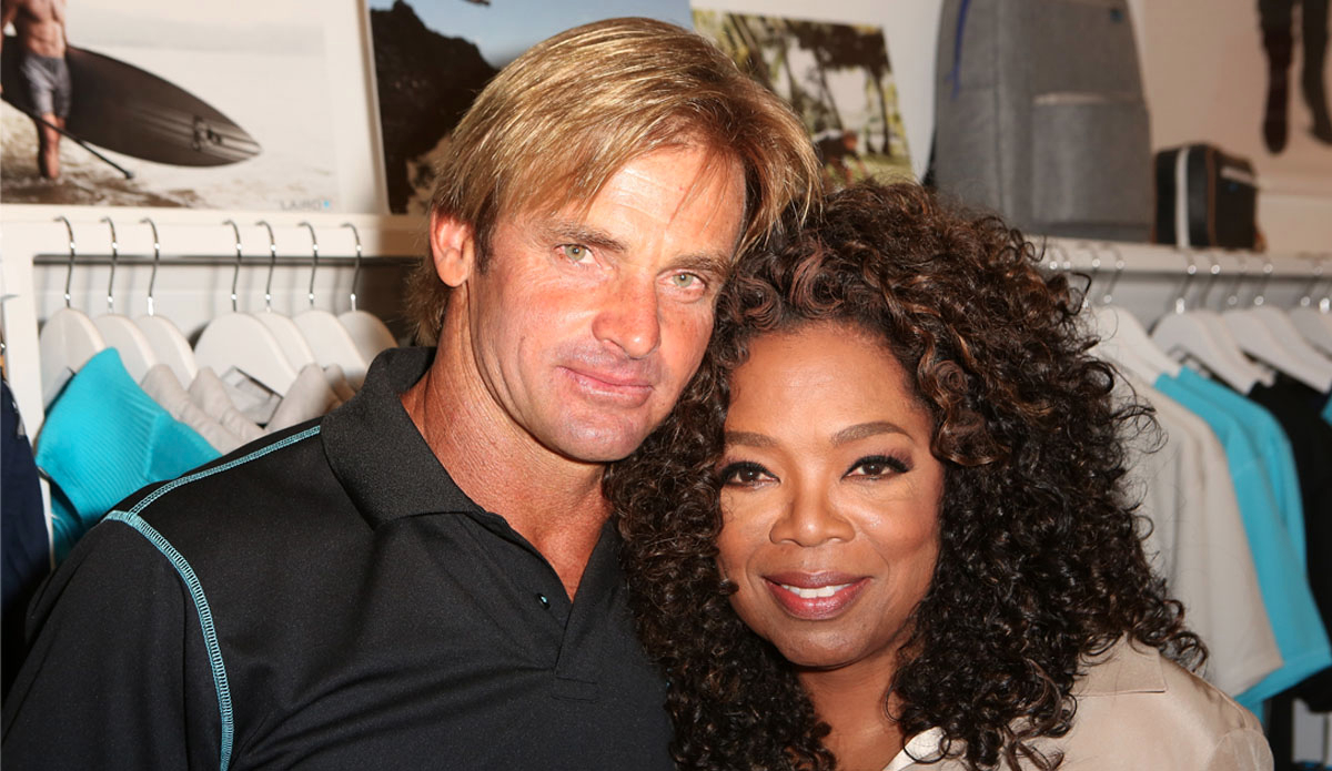 Laird Hamilton cozies up to Oprah Winfrey. (Photo by Ari Perilstein/Getty Images for Laird Apparel LLC)