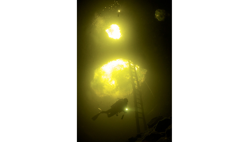 """Ascending from a dive at the entrance of Calavera Green light cenote. Photo: <a href=\""""http://liabarrettphotography.com/\"""" target=_blank>Lia Barrett</a>"""