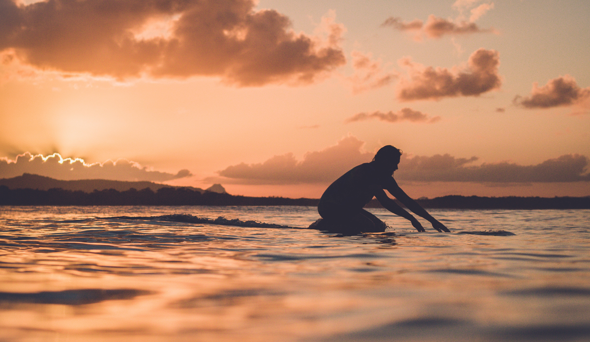 "Pat Saunders' (@pat.saunders) silhouette during a classic evening summer surf in Noosa Heads. Photo: <a href=""https://instagram.com/thomaslodin\"">@thomaslodin</a>"