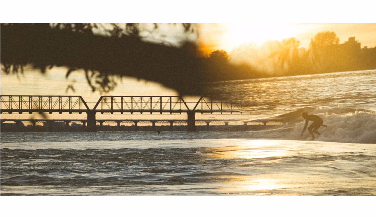 Renaud D\'Amours early morning river surfing session. Photo: Jeremy Lechatelier