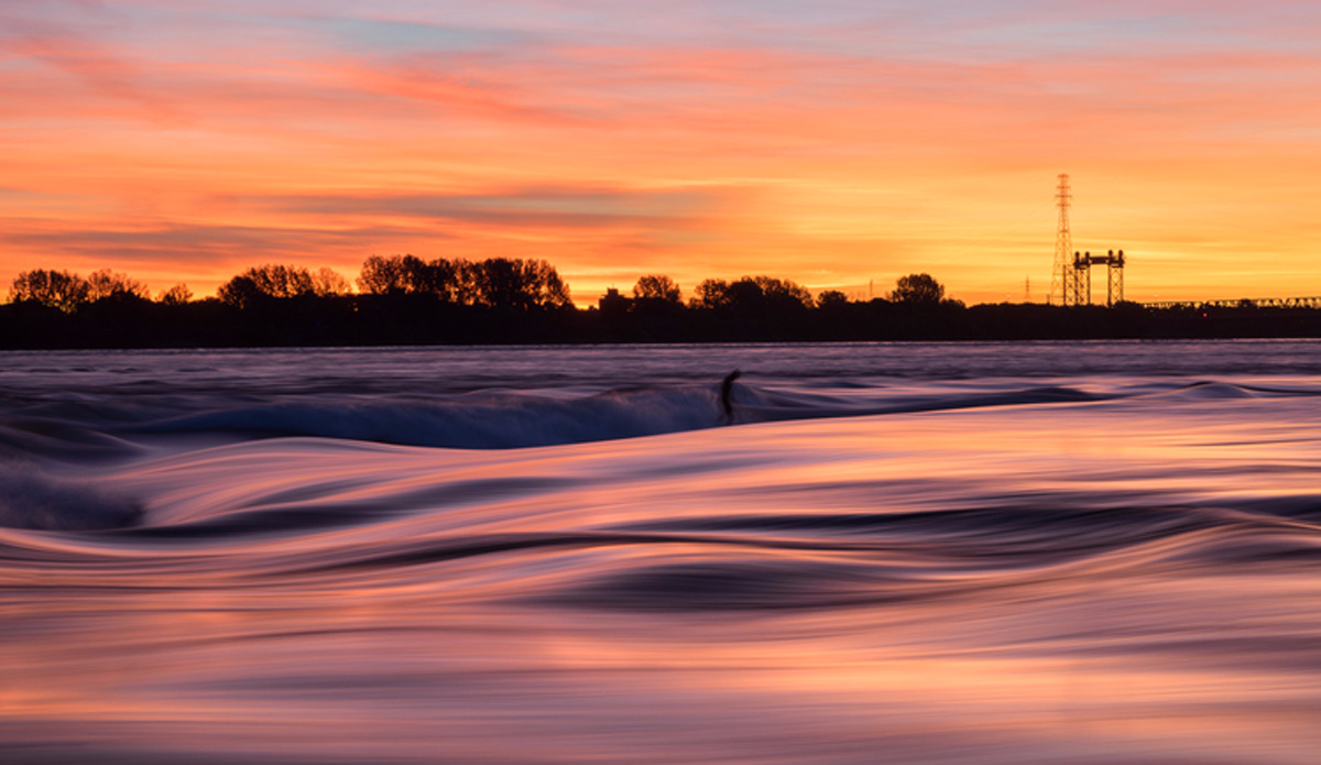 That magical moment. Renaud D'Amours living an amazing sunrise river surf session. Photo: Jeremy Lechatelier