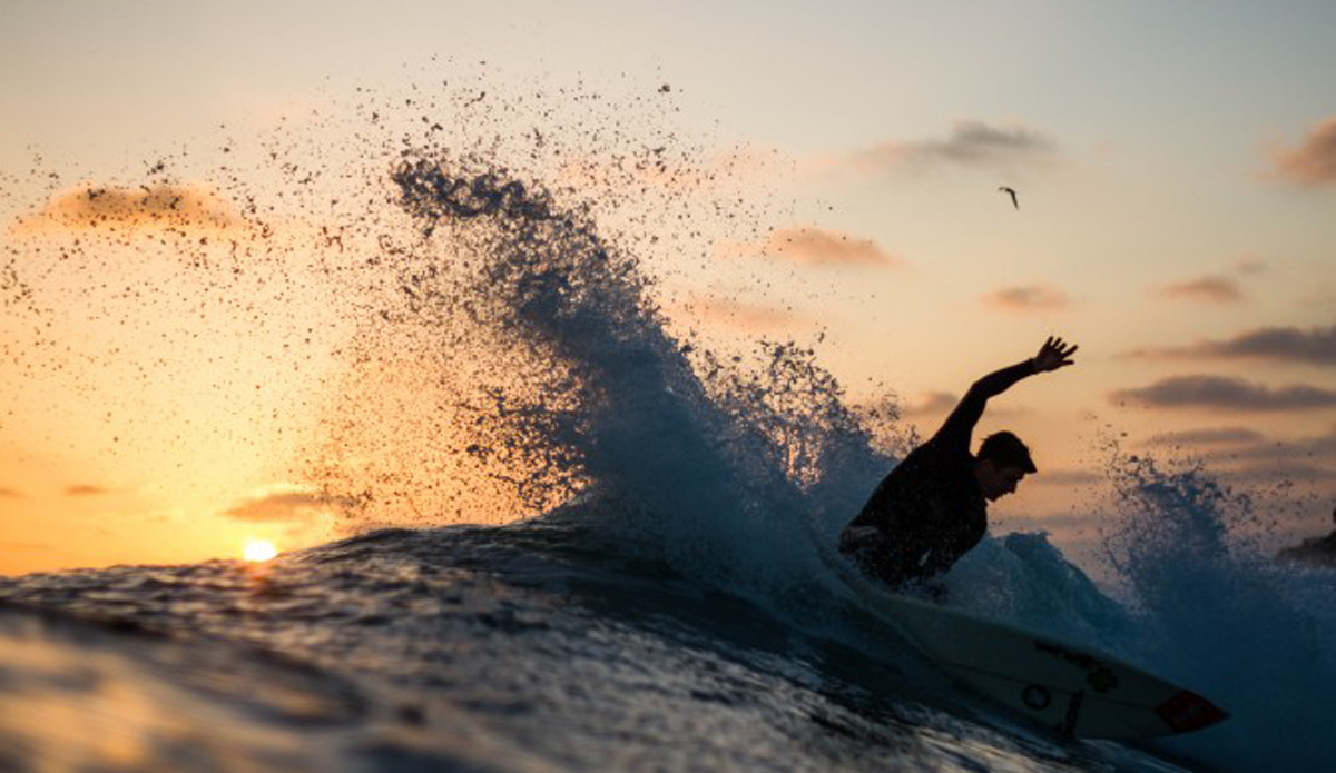 Chase Newsom spraying some water around during a nice, warm summer sunset.