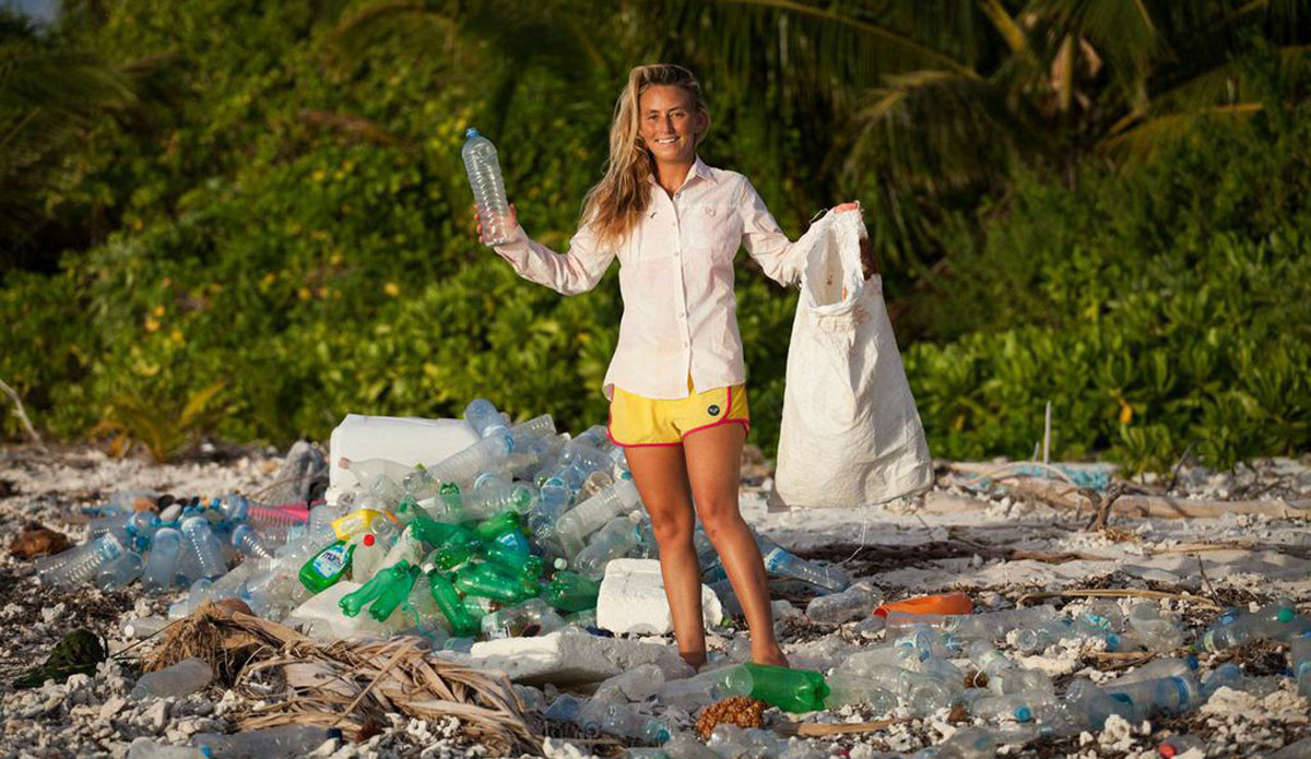 "I returned to this small island where I survived Discovery Channel's ""Naked and Afraid.\"" The pile of plastic behind me took only 10 minutes to clean up from about 50 feet of beach. These bottles drifted from all over the world. The Roxy board shorts I\'m wearing here were made out of 6 recycled plastic bottles. Photo: <a href=http://www.vivantvie.com/\"">Sarah Lee</a>"