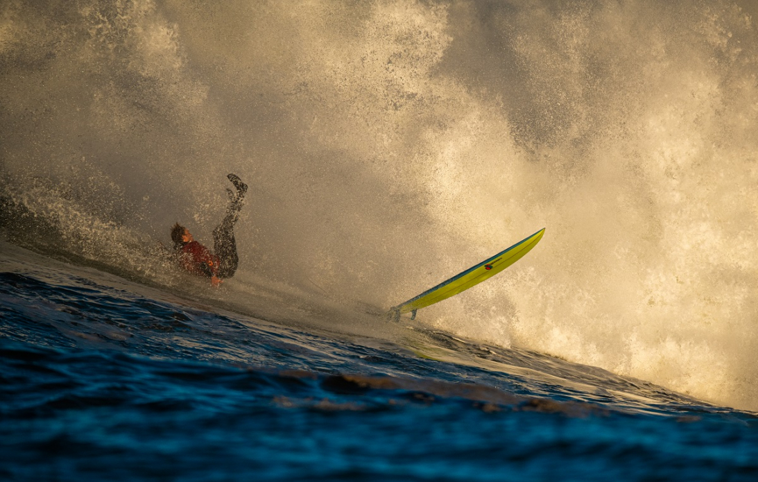 Not my favorite way of getting down a wave. Unknown surfer, taking his knocks. Photo: Euan Rannachan