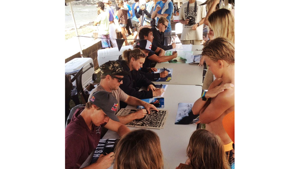 """A collection of some of the best surfers in the world signing new wallpaper for the kids. — Awesome · Head+++ (8ft+) · Glassy · Full. Photo: <a href=\""""http://goflow.me/\""""> Ian Walsh/goFlow</a>"""