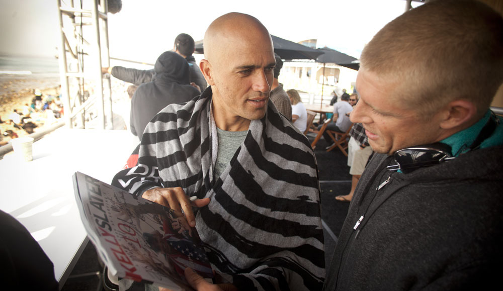"""That\'s a magazine I did with Surfing for his 11th world title, and I brought it to Trestles to give to Kelly, and he and Mick were checking out the book we did together. It\'s a pretty cool moment. Photo: <a href=\""""http://t-sherms.com/\"""" target=\""""_blank\"""">Steve Sherman</a>"""