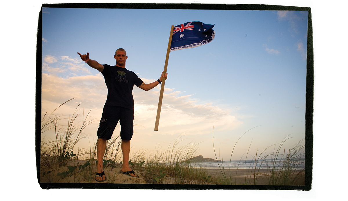 ""\""""His first world title in 2007, and I brought this flag, and I had the idea of him on top of the hill for Australia, like a battle. So he gave me ten minutes and we went across the sand dune in Brazil and we shot that photo, and I thought it really summed it up: Australia taking ground."""" Photo: <a href=""""http://t-sherms.com/"""" target=""""_blank"""">Steve Sherman</a>""1200|695|?|en|2|64620b2f7c07b8c66f91297c5ee0b342|False|UNLIKELY|0.33437901735305786