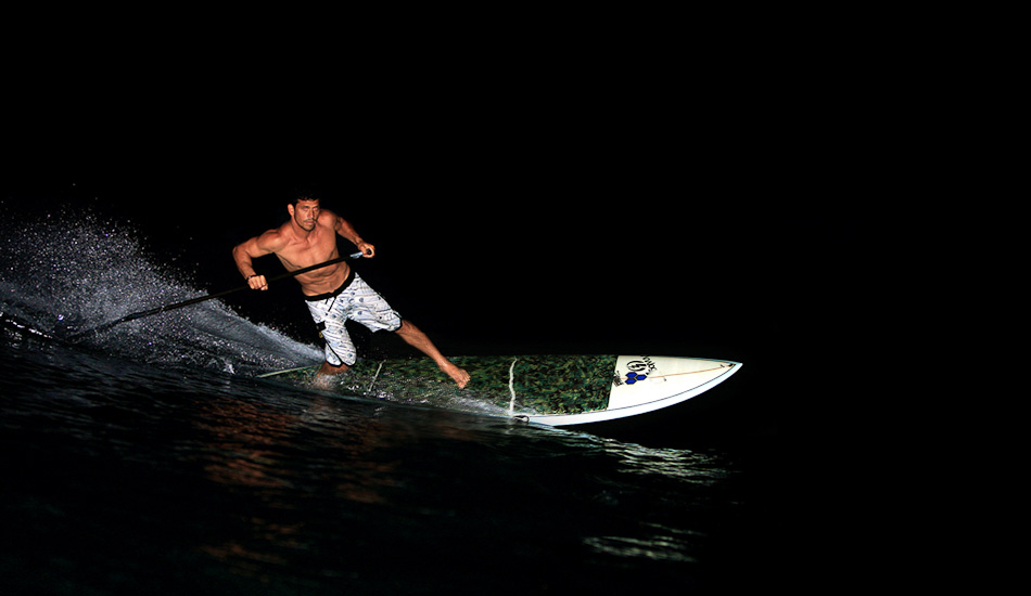 "Kamalei is one of my favorite althetes to shoot. He has a lot of talent and heart. I have probably shot him more than anybody else. Channel Island Surfboards sent him some SUPs and we had fun goofing around in the dark. Hardest part is getting the focus to catch. I shot it on another SUP without a water housing, but use a pelican case. On-camera flash shot at 1/200@f5.6 ISO 200. Photo: <a href=""http://www.mikecoots.com\"">Mike Coots</a>"
