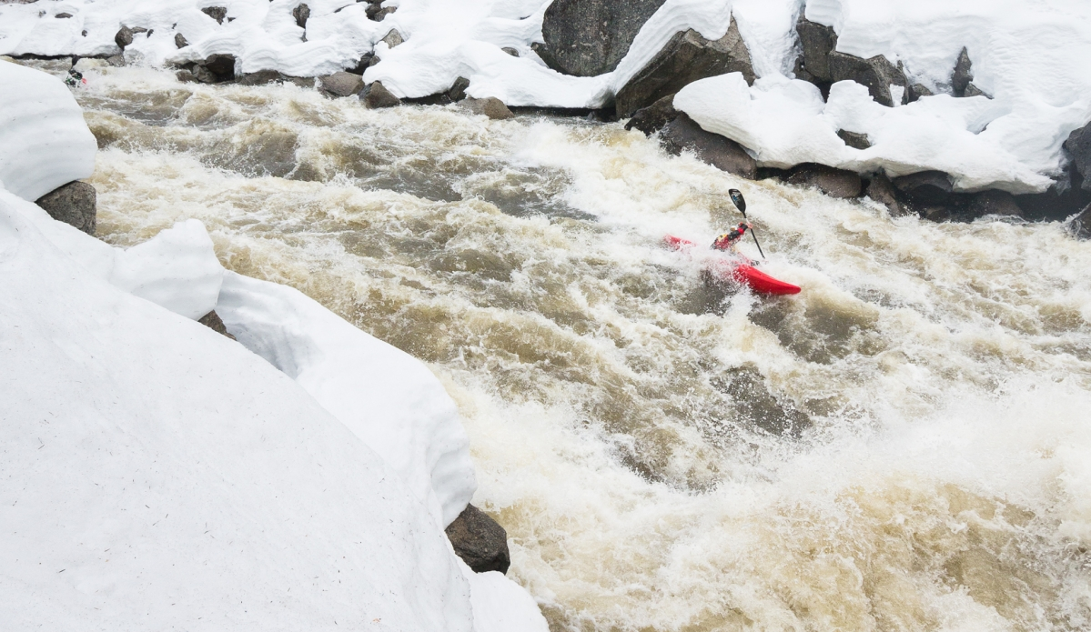 """The North Fork Payette has roughly 1600 ft. of vertical drop, so the rapids at the beginning of the section usually collect snow in the winter due to it's starting elevation. But what usually doesn't occur is 3 feet of snow on the banks and high, spring flows at the same time. When @nicktroutmankayak and crew descended the entire stretch (excluding Jacobs Ladder) they were practically running the stretch blind. Scouting was at a bare minimum,  the usual scouting pullouts were blocked by snow. Luckily @alecvoorheeskayak, @smstoenner, and Sam Wells were there to show Nick the lines. """"I can't express how much I feel that I'm about to drop into the unknown"""" -Nick Troutman."""