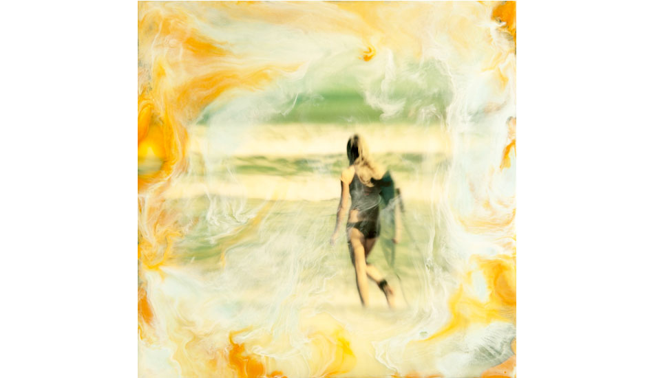 """This is an image of a young lady entering the water. I mounted a print on a 8X8 inch wood cradled panel, and cover it in beeswax and damar resin, and then added pigmented wax using a heat gun to create the swirls of color to give it a dreamlike appearance. Photo: <a href=\""""http://www.marksainwilson.com/?splash=1\"""" target=_blank>Mark Wilson</a>"""