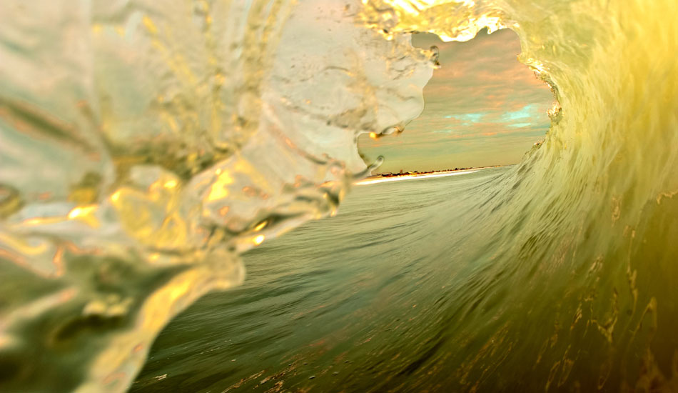 """This image symbolizes the reason I wanted to take my camera into the ocean to start with. The view of looking out of the tube for sure, but also, all the colors, moods, and moments experienced only by surfers. This view is what unites surfers worldwide into this lifestyle of the endless pursuit of waves. Photo: <a href=\""""http://www.marksainwilson.com/?splash=1\"""" target=_blank>Mark Wilson</a>"""
