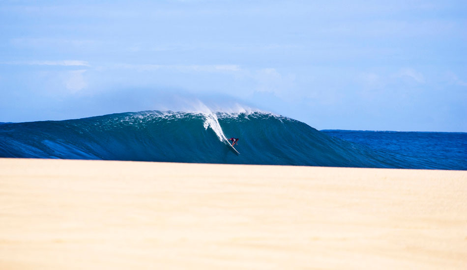 "Magnum Martinez on a Pipeline Bomb. I shot this well before all the sand had been washed away. Laying down and just waiting for it to all line up. The sand was gone soon after. One of my best Hawaii shots. Photo: <a href=""http://www.natesmithphoto.com/\"" target=\""_blank\"" title=\""Nate Smith Surf Photos\"">Nate Smith</a>"