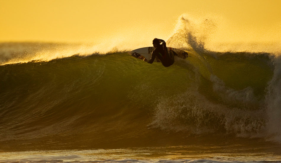 "Jordy Smith sunrise at Bells a couple pf years ago. Bells isn\'t an easy wave to surf but I always dig the way it makes these pros speed line – something classic about it even though there not busting out huge airs. Photo: <a href=""http://www.natesmithphoto.com/\"" target=\""_blank\"" title=\""Nate Smith Surf Photos\"">Nate Smith</a>"