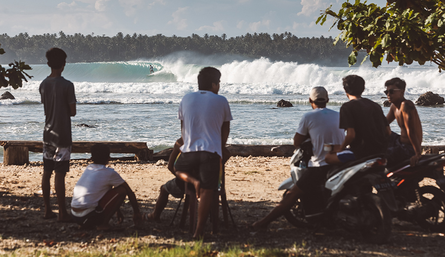 The locals have been very successful in protesting the Government planned roadway that would jut out just past that first line of whitewater, changing the wave and its troubled surf culture forever. Photos: Jenya Ivkov