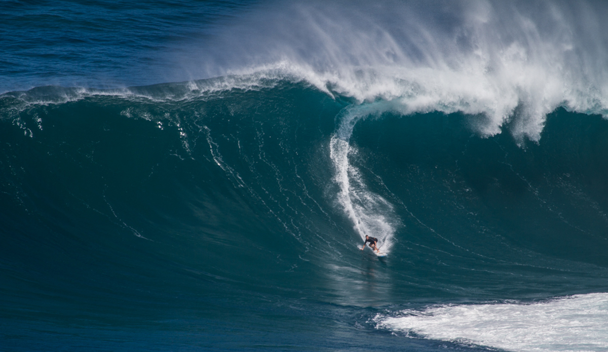 """Twiggy on a Pe'ahi bomb. This swell was unreal and the level of performance just keeps getting higher and higher out there. Photo: <a href=\""""http://www.nickricca.com\"""">Nicks Ricca</a>"""