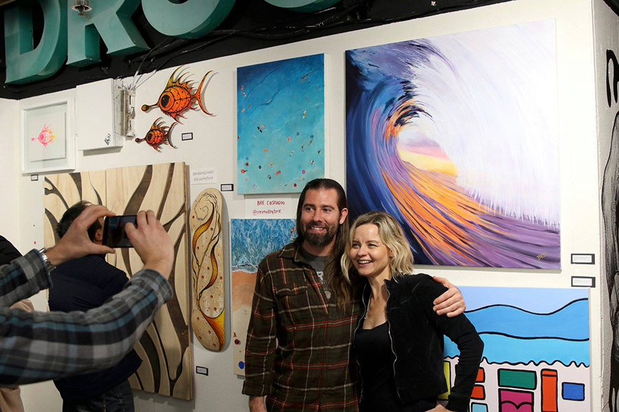 Ocean Stoke Artist Breanne Custodio stands for a photo with her artworks. Photo: Jerry Jaramillo