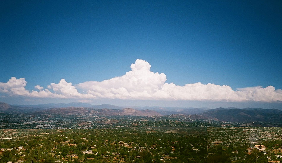 """August was a rough one this year in San Diego; the surf was flat for a month and it was really, really hot. The tropical weather made for some unreal clouds though, and I couldn\'t resist driving to the top of Mt. Helix on my way home from work one day to get a capture of them. Minolta TC-1, fuji superia 200 film. Photo: <a href=\""""http://fotoburns.com\"""">Adam Burns</a>"""