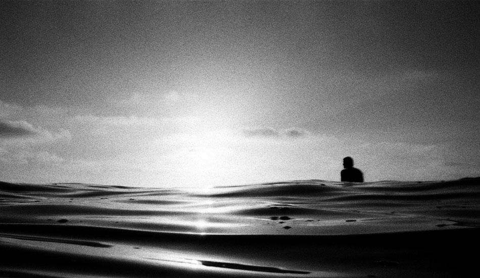 "Cris Loomis again, taking in the oil-glass sunset at the cliffs. Nikonos V, kodak tmax 3200 film. Photo: <a href=\""http://fotoburns.com\"">Adam Burns</a>"