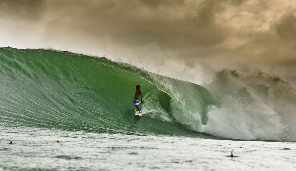 The waves were pumping on this trip, but the weather was overcast and raining a lot. Here is Dedi Gun, one of Indo\'s funniest free surfers. Photo: Brad Masters