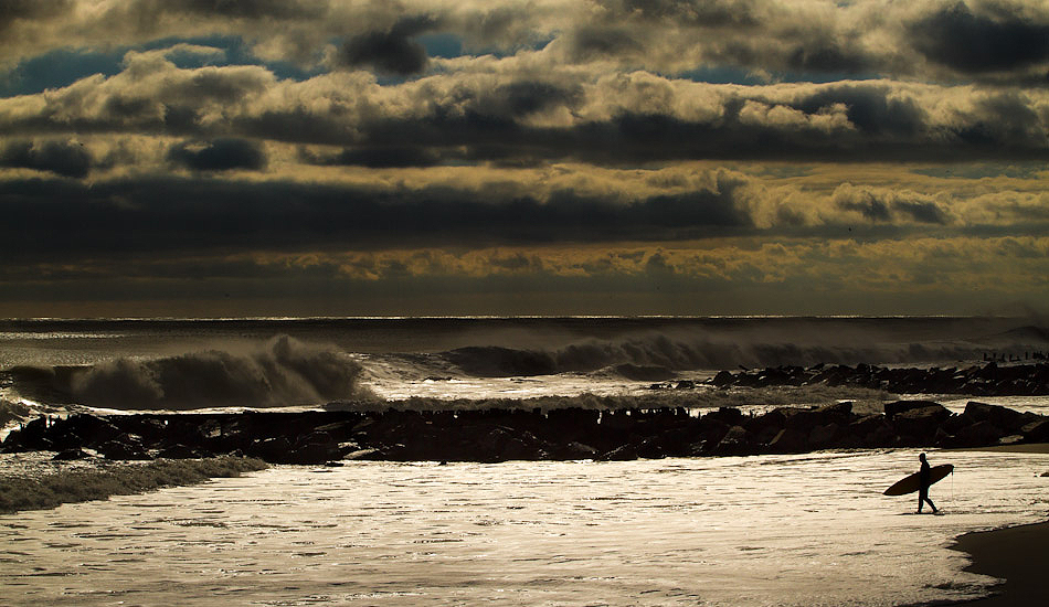 """Patches of light illuminate this surfer as he ventures into the lineup. Photo: <a href=\""""http://christor.photoshelter.com/\"""" target=_blank>Christor Lukasiewicz</a>"""