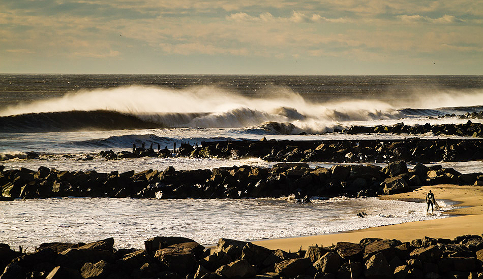 """Lone surfer in West End, NJ, going out for another epic ride. Photo: <a href=\""""http://christor.photoshelter.com/\"""" target=_blank>Christor Lukasiewicz</a>"""