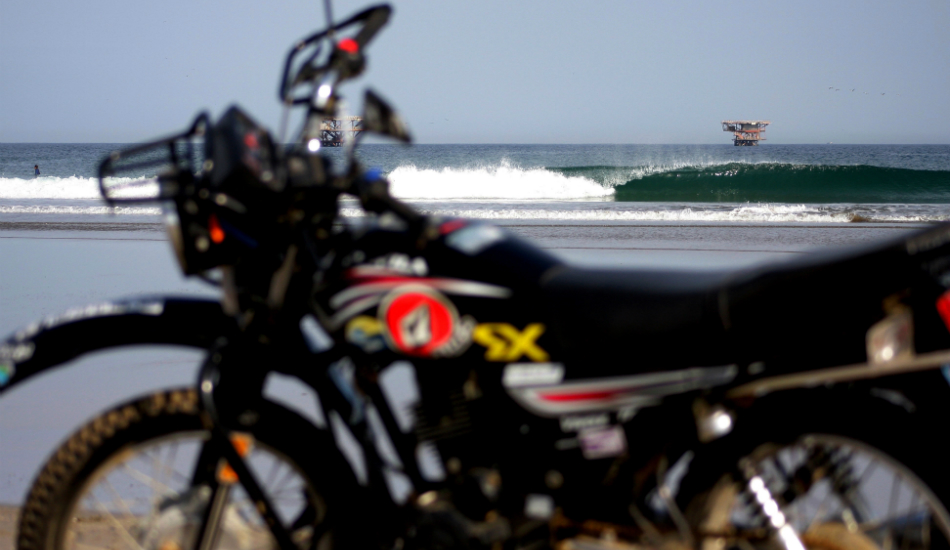 """Early one morning, there wasn\'t any wind. While I was waiting for the set I walked a bit from the beach to take a picture of the motorcycle and just behind was the perfect Lobitos wave (the point).   Photo:  <a title=\""""Henry Espinoza Photography\"""" href=\""""https://www.facebook.com/HenryEspinozaPhotography\"""" target=\""""_blank\"""">Henry Espinoza</a>"""