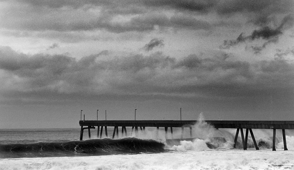 """Huge North Swell in Northern California, they shut down the pier. This spot is rarly surfed, but often surfable. Image: <a href=\""""http://www.paulferraris.com/\"""" target=\""""_blank\"""">Ferraris</a>"""
