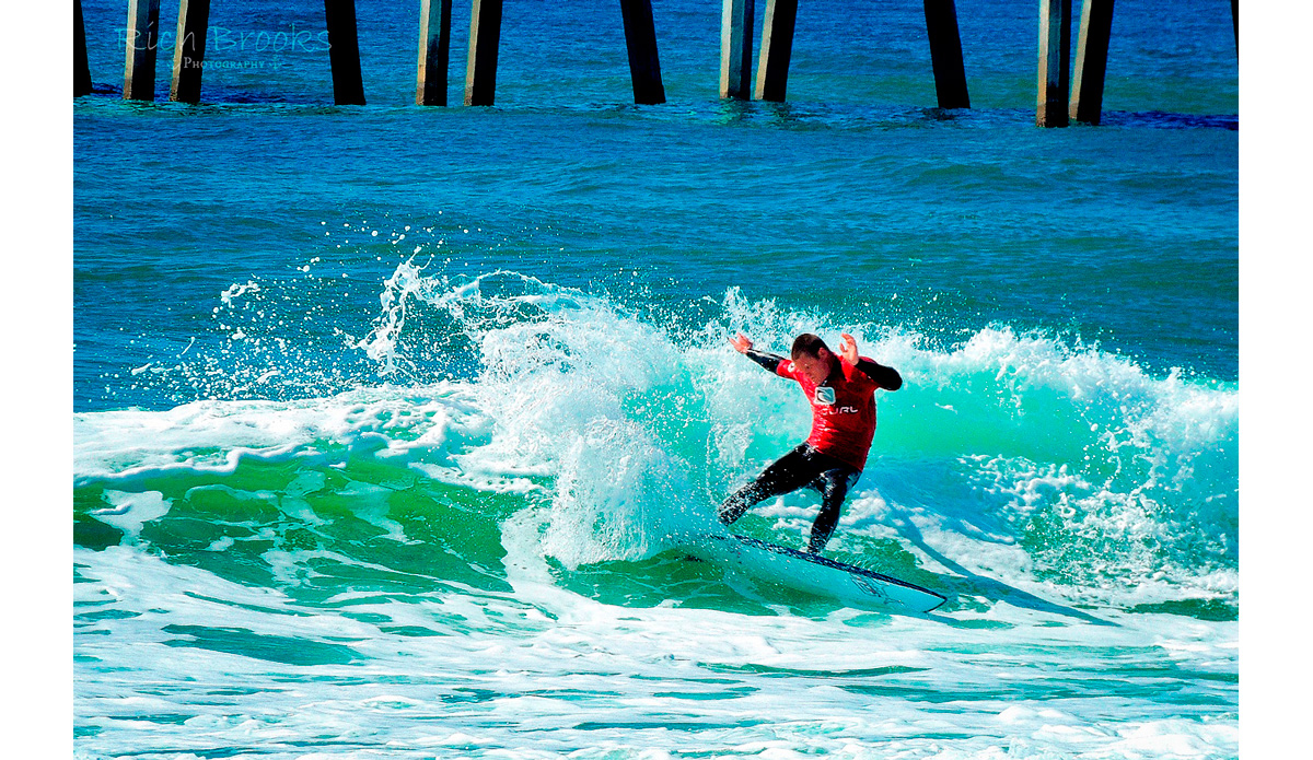 """Justin Buxton throwing up some spray at the Mr. Surf\'s Cold Water Classic surf competition. And by cold water, they mean cold water relative to Panama City Beach. Photo: <a href=\""""https://richbrooksphotography.squarespace.com/\"""">Rich Brooks</a>"""